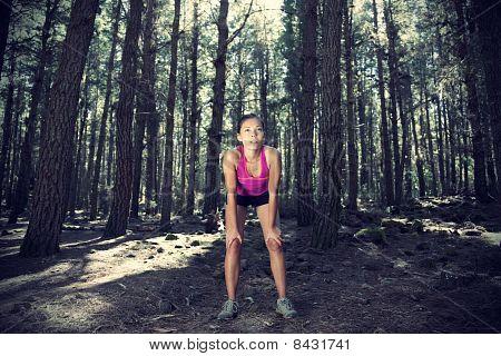 Female Runner In Forest