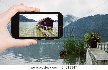 Tourist Taking Photo Of Shed On Schliersee Lake