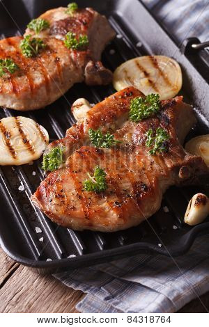 Two Grilled Pork Steak In A Pan Grill Close-up. Vertical