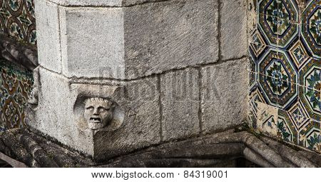 face in a castle wall