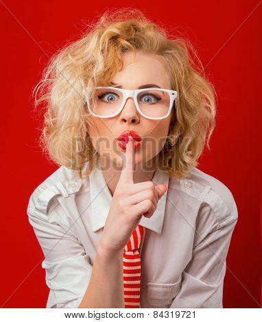 Woman Holding Finger On Her Mouth Showing Sign Silence