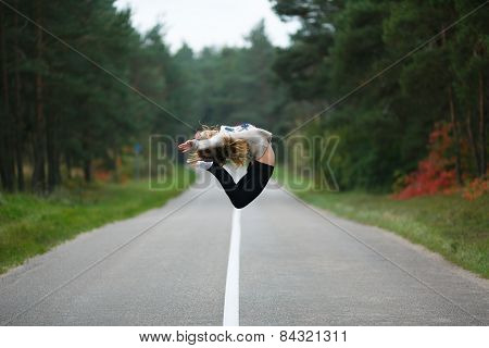Young Girl jumping on road