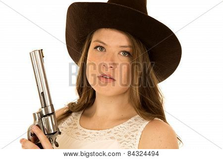 Close Up Of A Cowgirl Holding A Big Revolver With A Serious Facial Expression