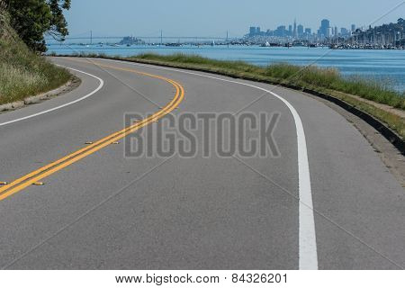 Curved Road With Double Yellow And Water