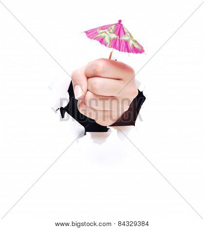 Cocktail Umbrella with human hand isolated against white