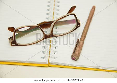 Notebook Open To A Blank Ruled Paper Sheet
