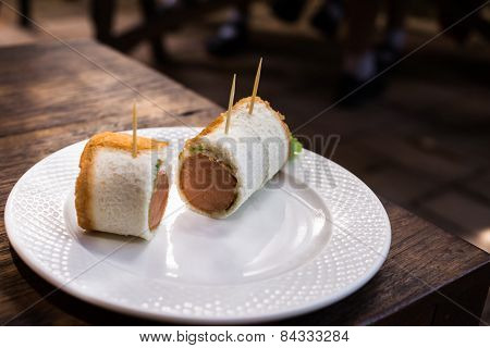 Sausage Cheese Rolls on white dish.