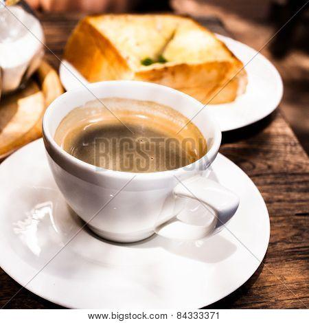 black americano coffee and garlic bread on the table.