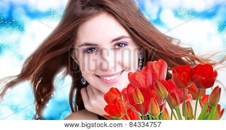 Beauty Woman With Beautiful Bouquet Fresh Red Tulips