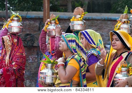 Indian Women With Pot On Their Heads In Ritual Procession On The Street In Vrindavan