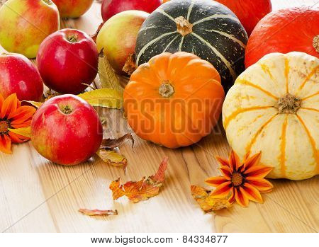 Pumpkins With Red Apples And  Fall Leaves
