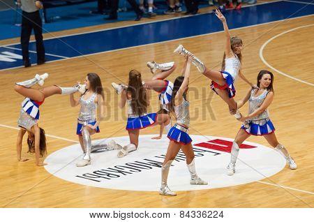Cheerleaders Dance On Basketball Arena