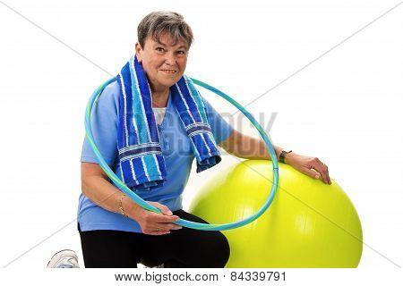 Senior Woman With Fitness Ball And Hula Hoop