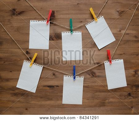 Hanging blank note tags with colored clothespins