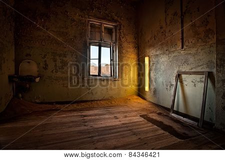 An abandoned room in Kolmanskopp, Namibia.
