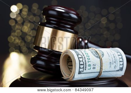 Gavel With Rolled Banknote