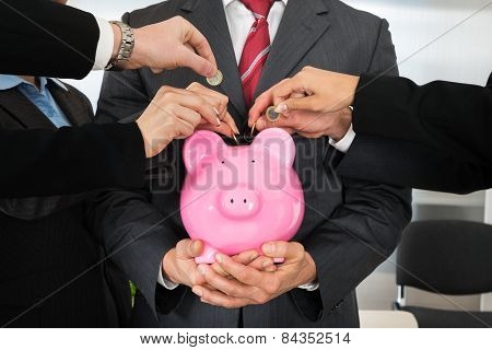 Businesspeople Hands With Coins And Piggybank