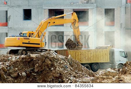 Yellow Excavator Working At Construction Site