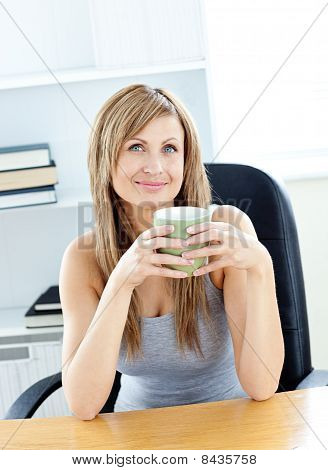 Relaxed woman holding a cup