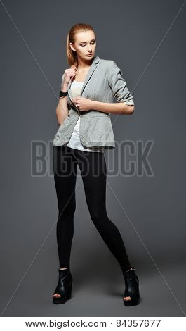 Studio Fashion Shot: Beautiful Young Woman In Leggings, Jacket And Shirt