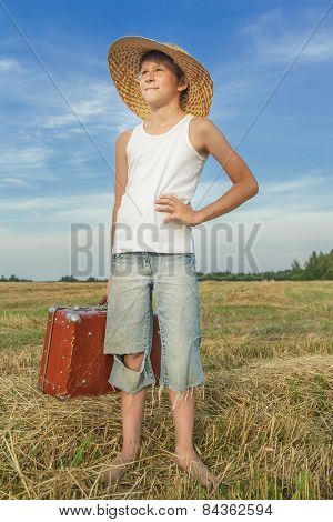 Cheerful Teenager Hitchhiker In Countryside Field