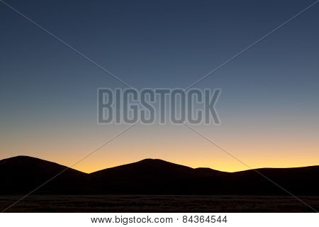 Last light glows above the dunes in Sossusvlei, Namibia.