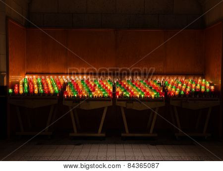 Candles In Colorful Glasses