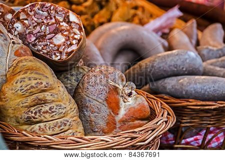 Traditional Sausages Placed In A Wicker Basket