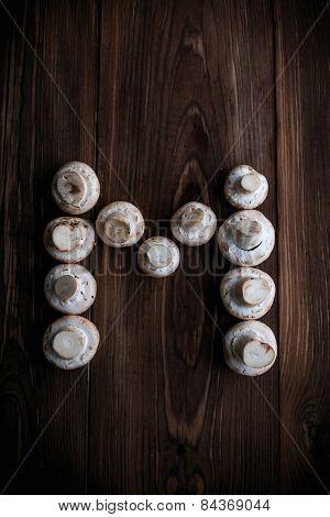 White Mushrooms On Wood Table