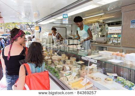 Vendor Selling Cheese At The Saint Aubin Market