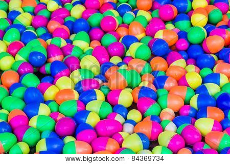 Colorful Plastic Eggs Toys Floating On The Water Background