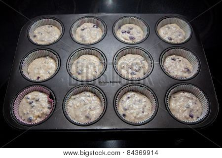 Raw Blueberry Muffins In A Backing Dish