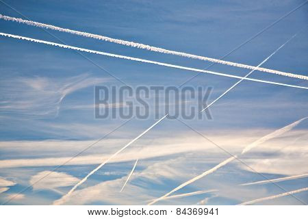 Airplane Vapor Trail On Blue Sky