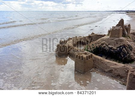 Sandcastle on the water's edge
