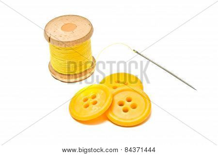 Plastic Buttons And Spool Of Yellow Thread