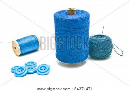 Spools Of Blue Thread And Ball Of Yarn