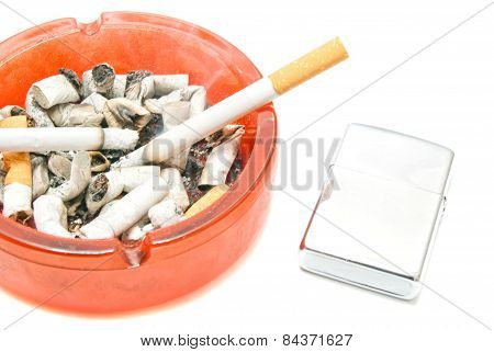 Two Cigarettes And Lighter On White