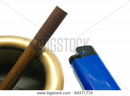 Cigarette In Ashtray And Blue Lighter