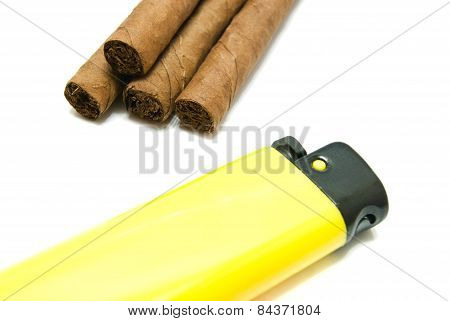 Few Cigars And Yellow Plastic Lighter