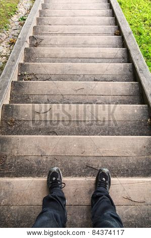 Male Legs Stand On Old Wooden Stairs