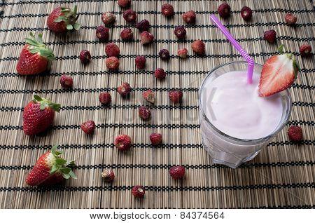 Strawberry Milkshake With Strawberries On Background