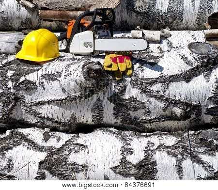 Chainsaw And Helmet On A Background Of Wood Texture
