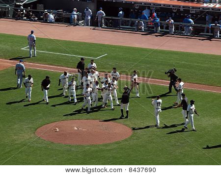 Giants Andres Torres Gets Mobbed By Teammates