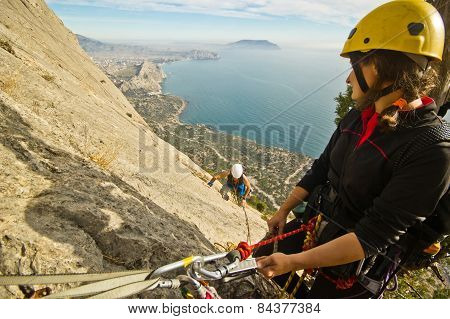 rock climbers ascend the mountain