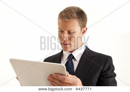 Young businessman on touch screen tablet computer