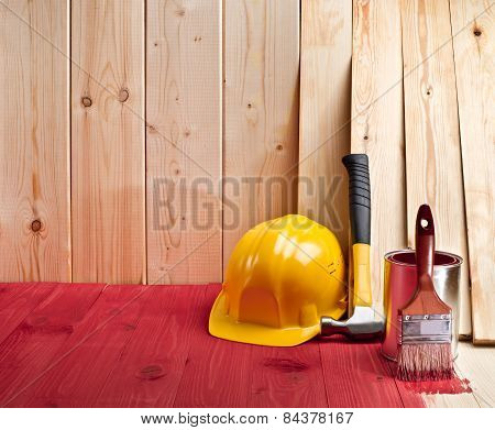 Wood Floor And Wall With A Brush, Paint, Hammer And Yellow Helmet
