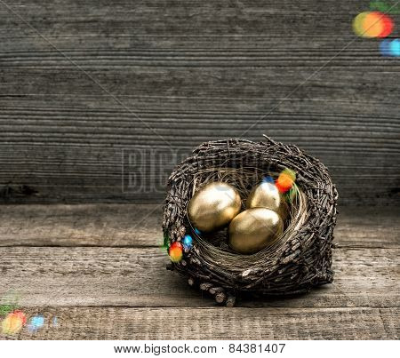 Golden Easter Eggs On Wooden Background With Light Leaks