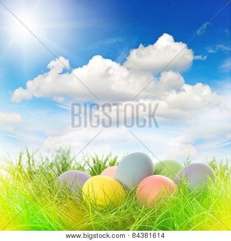 Easter Eggs In Grass. Sunny Blue Sky With Sunbeams And Light Leaks