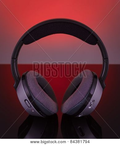 Professional Wireless Audio Headphones. On A Red Background.