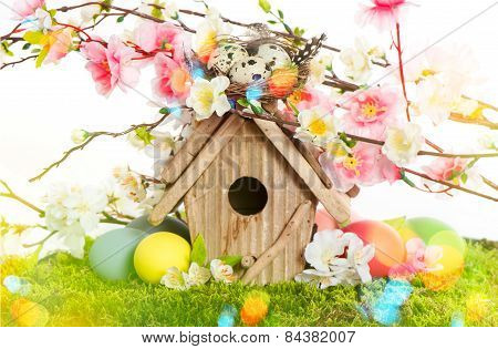 Easter Decoration With Birdhouse And Eggs. Spring Blossoms